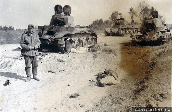 На фото: По всей видимости место тарана танка Фромме. В пользу этого говорят сбитые запасные траки немца (на снимке лежат на дороге левее позирующего немецкого солдата). Судя по следам после тарана танк Фромме уполз вправо, где застрял на заболоченном лугу у кладбища. Подбитый БТ-7 скорее всего врезался в него потому, что мехвод был убит попаданием практически точно в смотровой прибор в люке. Командир и башенный стрелок покинули  машину (башенные люки открыты), но им было не до драки с Фромме. Они горели. Танкист, лежащий на переднем плане, пытался скинуть с себя горящий комбинезон. В танке, который на снимке справа,  в люке сгоревший механик-водитель, так и не сумевший покинуть горящую машину. Вечная память павшим за Родину.